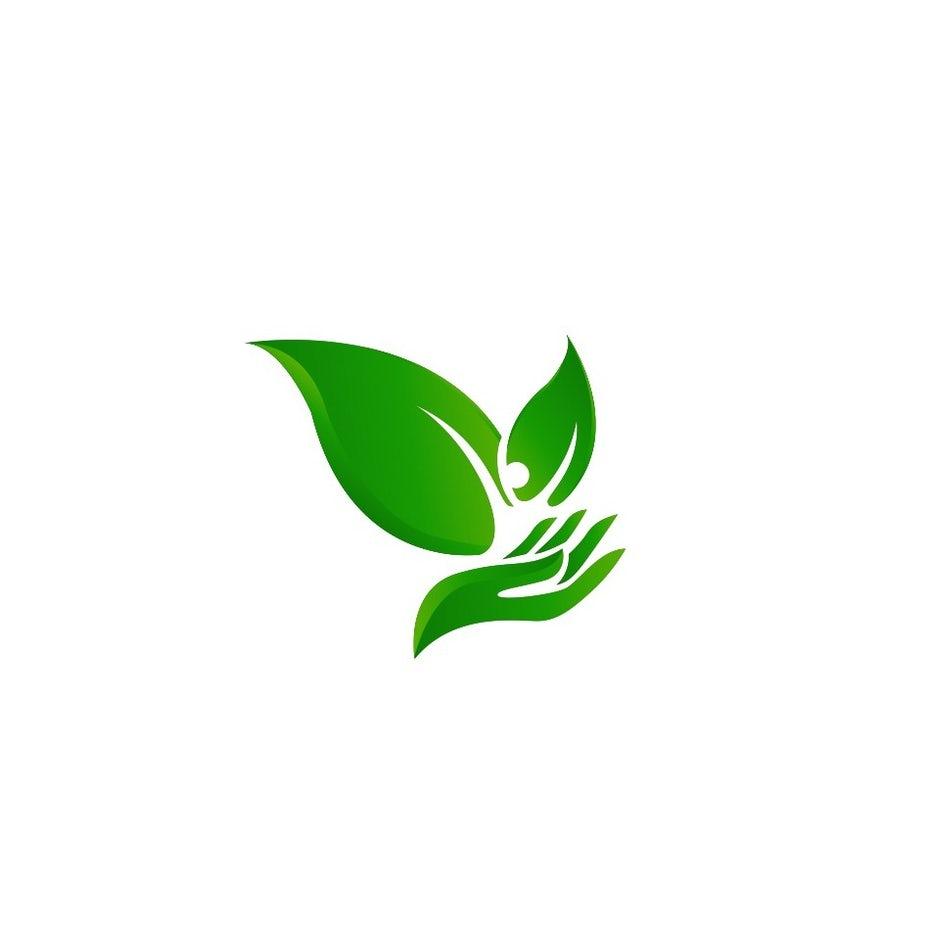 зеленые листья и экологический логотип в виде руки