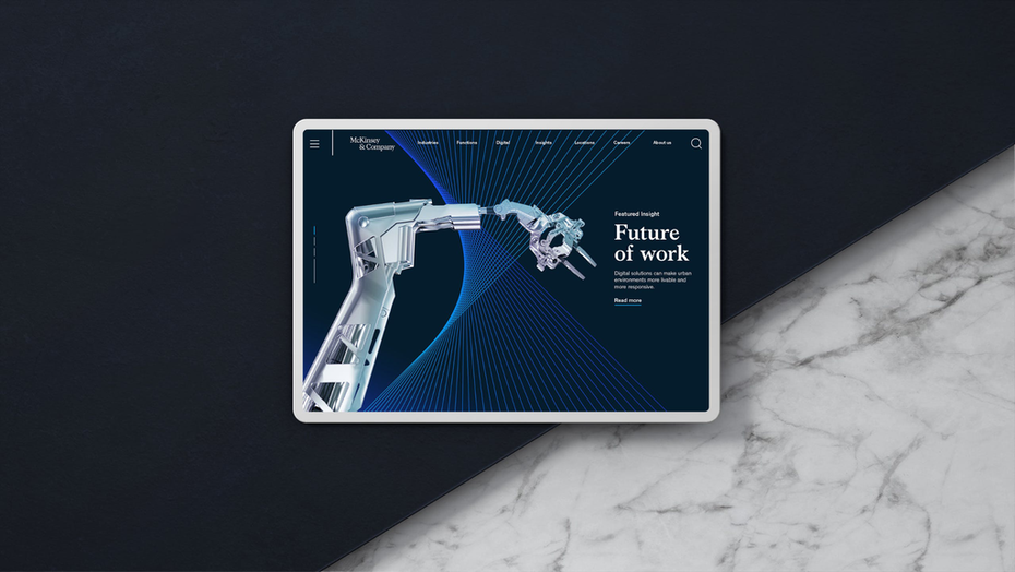 """a tablet displays a white and silver robot against a blue background"""" width=""""2048"""" height=""""1153"""
